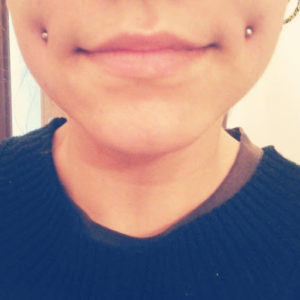 cheek piercing