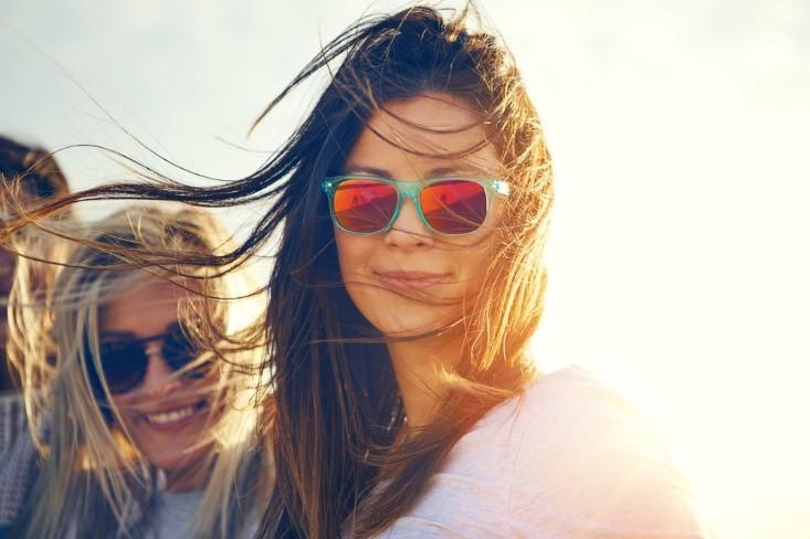 Two Beautiful Women Wearing Sunglasses