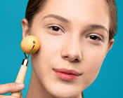 Beautiful white girl using a face roller